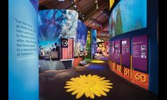 Daisies and peace signs projected onto the floor lead visitors through the 14,000-sq.-ft. Woodstock exhibition. #SEGD