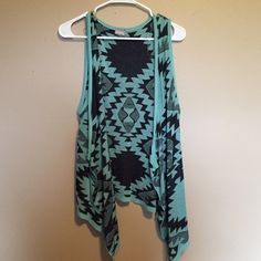 Tank Cardigan NWOT! Tank Top like cardigan! Very cute and never worn! Blue with black Aztec print.  •Reasonable offers considered! •No trades! •Pet Free! •Smoke Free! Vanity Tops Tank Tops