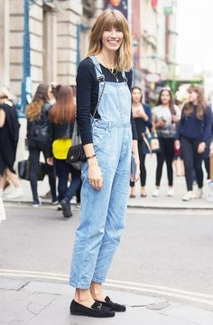 Casual outfit with light wash denim overalls and black loafers.