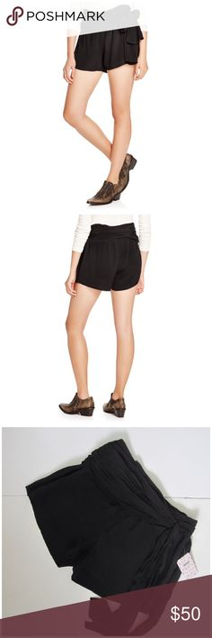Free people extreme faux wrap black shorts sz 2 Free people Extreme Faux Wrap Shorts      Ruched waist, high rise Concealed zip side closure Attached self-tie sash belt Rayon Machine wash Sz 2 New with tags Black Waist: 15in Inseam: 3in Length: 15in Free People Shorts