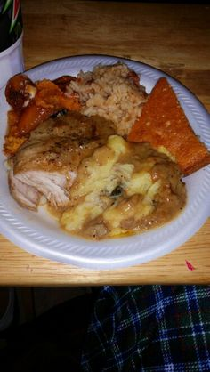 Baked chicken thighs, mashed potatoes with brown gravy. Candid yams &seasoned rice. Corn bread .