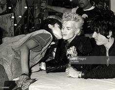 fan, Billy Idol and Steve Stevens during Billy Idol Signs Autographs of New Album 'Rebel Yell' in Hollywood - March 20, 1984 at Music and Record Shop in Hollywood, California, United States.