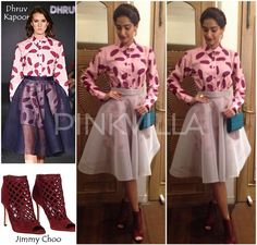 Her look included a pink banana leaf print shirt dress that she wore with a sheer full circle skirt. Picking color from the shirt, she styled her separates with a pair of burgundy mesh booties from Jimmy Choo, wing earrings from Micare and a blue Elie Saab sling bag.