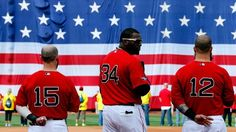 Boston Red Sox players sing the national anthem before Game One of the American League Division Series against the Tampa Bay Rays at Fenway on October 4, 2013.
