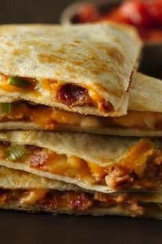 """This recipe had us at """"cheesy"""" and """"bacon""""! Twenty minutes is all you need to make these simple, savory quesadillas that are perfect for lunches, weeknight suppers, snacks or Game Day apps. Save your leftover bacon from breakfast to use, and prep will be even easier!"""