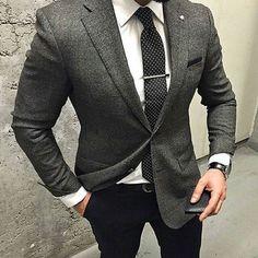 Shop this look on Lookastic: https://lookastic.com/men/looks/blazer-dress-shirt-dress-pants/19815 — White Dress Shirt — Black and White Polka Dot Tie — Charcoal Plaid Wool Blazer — Black Leather Watch — Black Dress Pants