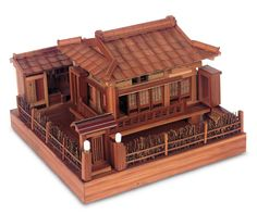 Japanese Wooden Model of Classical Teahouse,  Bamboo and wood,the detailed teahouse features exterior fence,lighted gateway,classic hipped roof,veranda with working sliding shoji doors with paper panes,separate well house,and is mounted on a square wooden base. Condition: generally excellent, minor losses. Comments: Japan, era,1950s,miniature models, temples ,home, ,teahouses and other classic Japanese elements were popular souvenir items following the opening of Japan in the late 19th…
