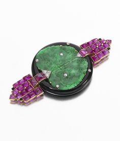 Important jadeite, onyx, ruby and diamond pendant-brooch, Cartier, circa 1925