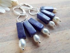 Blue Lapis Lazuli and White Cultured Pearl Earrings/ Sterling Silver - byLaurieB -   Cultured Pearls and rustic little Blue Lapis Lazuli  bricks, all clustered beneath my hand forged and hammered Sterling Silver rings .   * Solid Sterling Silver leverback Earwires and Pins ( not plated).   * Hand forged and hammered Sterling Silver rings   * Rough hewn Lapis Lazuli brick beads   * White cultured fresh water pearls   Drop is approx. 5cm ( 2 inches) from the top of the Earwire.   Gift wrap...