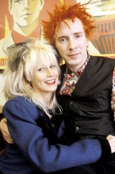 John Lydon & Nora Forster, married over 35 years. 'Now there's a saucy girl,' he grins. I've always loved that woman. When we met we didn't expect to get on. Johnny Rotten, 70s Punk, Punk Goth, Photo Rock, God Save The Queen, The New Wave, Star Wars, The Clash, Classic Rock