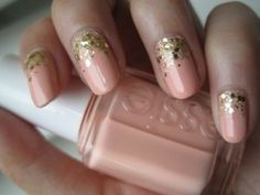 Pink/nude and gold sparkled ombre style nails .. Really pretty!