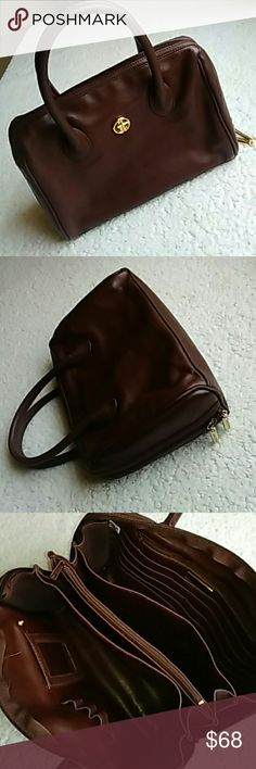 ◼ Giani Bernini Brown Leather Satchel ◼ ◼ Giani Bernini Brown Leather Satchel◼  ◾Gorgeous brown leather satchel ◾Tons of room inside with 2 lrg sections on ends ◾Separate section w/3 dividers ◾Credit Card Slots & zippered section ◾In excellent condition with very minimal to no signs of wear Giani Bernini Bags Satchels