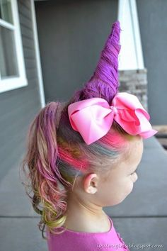 With a little piece of cardstock, some bobby pins, and color hair spray, you can give her a little horn and adorn it with a bow in this  unicorn hair tutorial .: