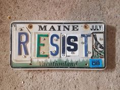 License plate sign RESIST vintage letters Sign Letters, Vintage Lettering, New Sign, Flip Clock, Helping People, Decorating Your Home, Signage, Automobile, Plate