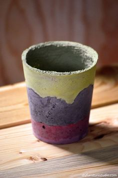 DIY paint-tinted cement pot.  This tutorial shows how to mix the paint with the cement, rather than painting the finished pot.