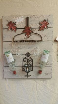 Pallet board, bed spring wine holder, repurposed. This is a Pallet board I made from some old trinkets I collected. Poohtinks Studio....like my page on FB!