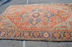Gorgeous and perfect size for the living room.  Antique Persian Heriz Rug With Center Medallion // Size 8x12 // Red, Light Blue, Navy, Green And Pinks // Hand Knotted Rug  $2,950.00  Antique Persian Heriz Rug Large decorative Heriz with center medallion and softened natural colors. Main colors are red, light blue and navy