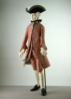 Formal 3-piece suit, France (fabric) and England, 1765-1770. French silk, patterned in cerise and cream, lined with horsehair, lined an backed with silk. Such a luxurious material would have been worn for the most formal evening occasions, such as theatre or the opera.