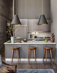 Small Modern Kitchen With Grey Shades And Gold Accents.