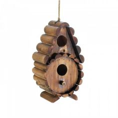 Round Log Birdhouse Little logs are stacked to create a lovely little home for the birds. This rustic wooden birdhouse is a great addition to your yard with two openings to welcome birds inside plus a classic log design that you'll love seeing daily. Wooden Bird Houses, Wood Logs, Log Furniture, Cool Lamps, Coastal Cottage, Little Houses, Log Homes, Coco, Outdoor Decor