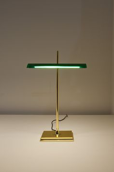 A great modern revamp of a classic banker's style lamp. It's the Goldman desk light by Ron Gillad for Flos. You can get it from us for around £370 at : http://www.italian-lighting-centre.co.uk/desk-task-reading/goldman-modern-green-bankers-light-from-flos-p-7398.html#.VP9UFOHeJL8