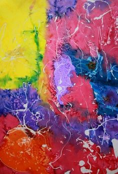 resist and salt - Drizzle rubber cement all over poster board or watercolor paper and let dry overnight. Paint liquid watercolor on top and sprinkle salt while still very wet. After drying, rub rubber cement off paper with finger.