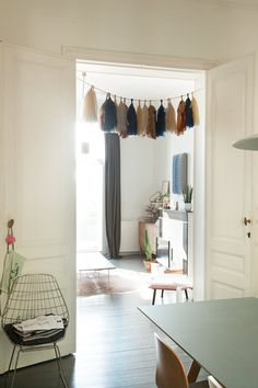 The Socialite Family | Tassels colorés dans la maison de Kelly Claessens et Benoît Deneufbourg à Bruxelles. #famille #family #bruxelles #brussels #belgique #belgium #design #lafabrika #benoîtdeneufbourg #white #blanc #colours #couleurs #scandinaviandesign #designlovers #homedecor #interiordecoration #livingroom #salon #tassels #inspiration #idea #home #thesocialitefamily