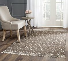Safavieh Natural Kilim Collection NKM316A Handmade Brown and Ivory Wool Area Rug, 5 feet by 8 feet (5′ x 8′) #handmade Add a fresh look to your how with a brand new rug from the Safavieh Kilim Collection.  Safavieh's Natural Kilim collection is inspired by timeless traditional designs crafted with the softest wool. These rugs are crafted using a hand-woven construction with a soft, premium wool pile. These rugs are sure to add the perfect accent to any room in your home. The handmade..