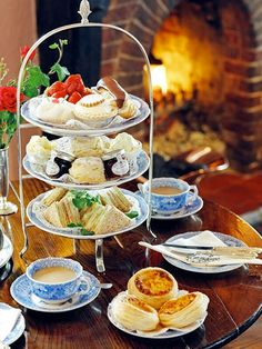 Tartlets, scones with jam and clotted cream, sandwiches, and crumpets.
