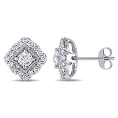 These extraordinary cushion-style stud earrings from the Miadora Collection each feature a sparkling round white diamond surrounded by a halo of smaller round white diamonds crafted in lustrous 14-kar