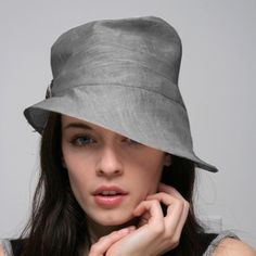 Pure linen hat in a lovely natural grey color linen. The rim has been finished with wire so it frames the head beautifully. It has been finished with a vintage buckle (each hat will be finished in it's own unique way, not necessarily the way in the picture).