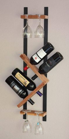 This unique zig zag wine rack & stemware holder adds an industrial chic element to your home decor. Made of redwood and hand hammered metal this piece sports a modern, vibrant look. The contemporary, decorative style will add a clear, fresh energy to any kitchen, dining or bar area. -