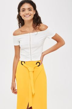 In stretchy ribbed cotton, this stylish cream crop top has been updated with on-trend hook and eye fastenings to the front. Team this short-sleeved style with your favourite jeans for a laid-back look.