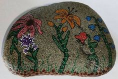 I looked at this rock and envisioned a flower garden - this is the result. Rock Painting, No Time For Me, Painted Rocks, Mandala, That Look, Inspired, Creative, Garden, Flowers