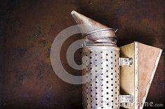 Vintage beekeeping smoker on rusty background