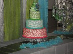 """Quinceanera Cake - 14"""", 10"""", and 6"""" white chiffon cake with strawberry filling and buttercream frosting...made for a masquerade themed Quinceanera."""