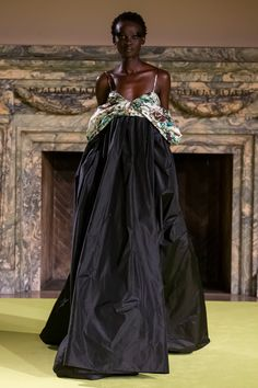 Black silk faille empire waist gown with green floral draped off the shoulder bodice