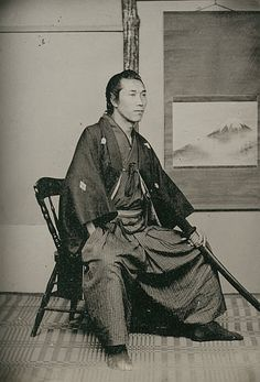 "Photograph by Shimooka Renjo; ""Samurai Uchida""; Charles Schwartz. At the end of the samurai era, once fierce warriors had enough time on their hands to sit for portraits. This aristocratic samurai from the late 1800s posed with his katana sword prominently displayed and still in its scabbard with the cords tied."