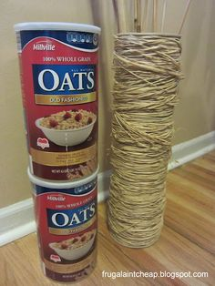 "Tall ""Vase"" from oatmeal containers and rafia!  Be sure to weight the bottom."