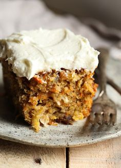 Perfect Carrot Cake! This one is so easy, made in a 9x13 pan, loaded with extras and topped with creamy frosting!