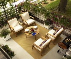"""Fencing and plants create """"walls"""" and add a sense of privacy to this patio room. A pretty fountain (located behind the top chair) adds the sound of water to help screen out street noise."""
