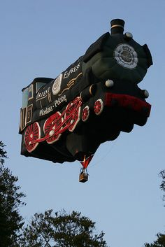 """""""Hot-air Steam Train Special Shape: The Orient Express steam train special shape hot-air balloon is now sponsored by Warsteiner beer. It is seen at Barneveld, Holland."""" Phot by stuart spicer, via Flickr. Another view here: http://www.flickr.com/photos/spicpix/4221909541/"""