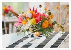 vibrant floral centerpiece and striped linens