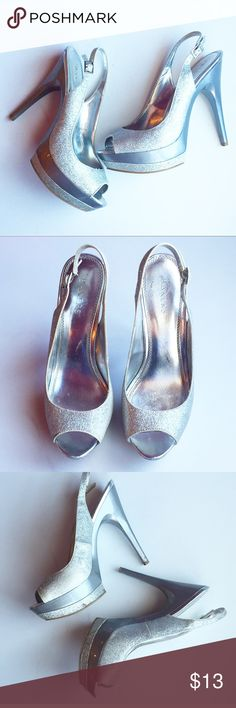 Bakers Silver Glitter Peep Toe Platform Heels Bakers Silver Glitter Sparkle Peep Toe Platform Pumps  ❥ Size 8.5  ❥ Glitter is scratched on inside of shoe as shown. Not noticeable when wearing. Minor scrape on heels ❥ Few scrapes on foot of shoe due to pesky sticker tags from the store that were hard to get off! (Can't see when wearing! ❥ 5 inch heel, 1.5 inch platform ❥ Great for formals and proms! Bakers Shoes Heels