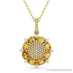 The featured pendant is cast in 14k yellow gold and showcases oval cut citrine gems & round cut diamond accents.