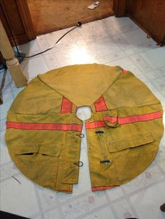 Firefighter bunker gear tree skirt - I LOVE this! I wish I had my dad's old coat...