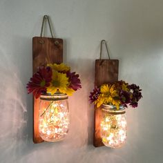 Rustic country decor mason jar wall sconce. All natural handpicked wood, sanded and stained in Early American with natural rope to secure the jar in place. The mason jars are clear 16oz jars. The sconces are about 13 inches long, the wood is about 12 but when hanging on the wall is