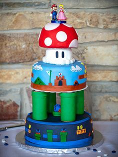 AMAZING Super Mario Bros. wedding cake. Other cool designs in this slideshow (just ignore the ignorant captions - The Knot doesn't seem to get that personalized cakes kick ass)!