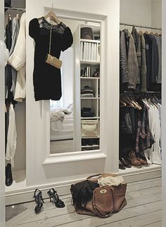 I have a large window {over looking the street} between two closets. I think I could make a sliding door with a mirror to close off the window at night for total privacy.