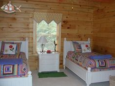 The interior design choices of the bedroom furniture and especially the linens create a theme not commonly seen in log cabins, but a theme that is more and more common in today's log homes.